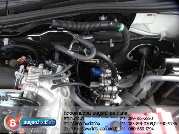 ตำแหน่งการติดตั้งหม้อต้มแก๊ส (Reducer) ที่มากับชุด Advanced OBD - Energy -Reform ในห้องเครื่องยนต์ Mitsubishi Pajero Sport 2400 cc. ป้ายแดง กับชุด Advanced-OBD 4 สูบ ของ ENERGY-REFORM พร้อมถังโดนัท  51  ลิตร ใต้ท้องรถ โดยธนบูรณ์ ออโต้แก๊ส