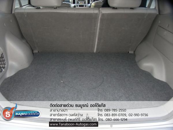 ติดตั้งถังแก๊สเรียบร้อย เมื่อวางพรมที่ท้ายรถบริเวณที่เก็บของพื้นก็จะเรียบ สามารถเก็บของหรือวางยางอะไหล่ด้านบนได้ ตัวอย่างผลงานการติดตั้งระบบแก๊สรถ Mazda Tribute 2300cc ติดแก๊ส LPG หัวฉีด ชุด Prins VSI อุปกรณ์นำเข้าจากเนเธอร์แลนด์ ติดถังโดนัท Metal Mate 52ลิตร พร้อมมัลติวาล์ว Energy Reformโดย ธนบูรณ์ ออโต้แก๊ส